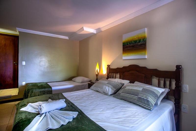 Quarto e cama no Castelo Beach Hotel em Natal